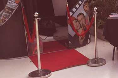 red carpet, rope and pole